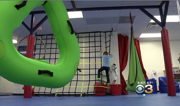 kid climbing rope wall